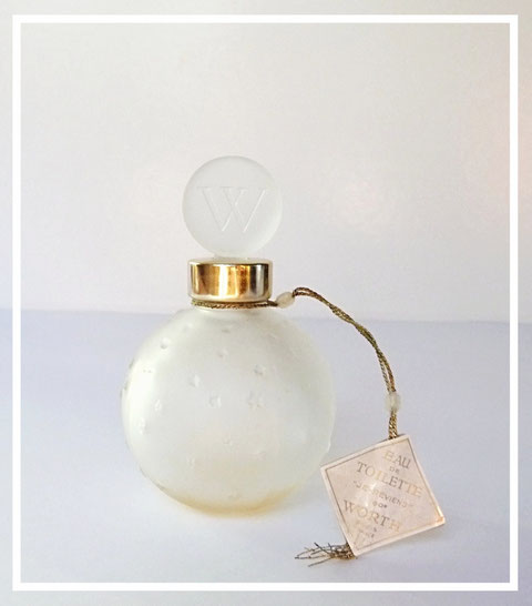 WORTH - JE REVIENS EAU DE TOILETTE : FLACON BOULE ETOILEE, CREATION LALIQUE.