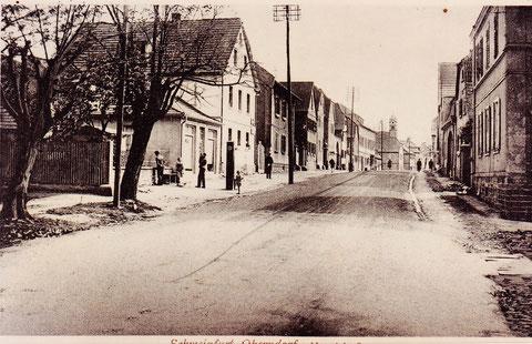 Hauptstraße, vom Weiher aus gesehen, um 1930