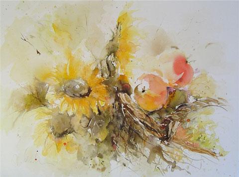 Obstkorb und Sonnenblumen