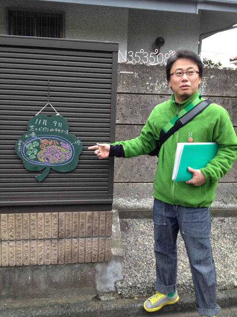 プロジェクトの説明をする池田光宏さん。池田さんの頭のむこうに見えている数字は、谷山恭子さんのプロジェクト I'm here