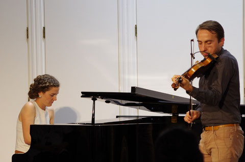 Oisin MacDiarmada and Samantha Harvey performing at a concert in Tokyo