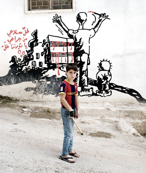 Boy with Mural in Dheisheh Camp