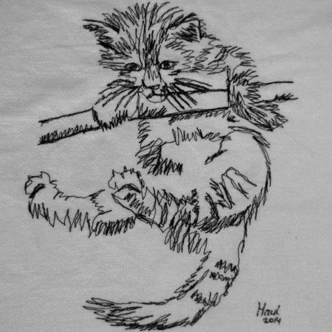 Mit der Nähmaschine genähmalte Katze