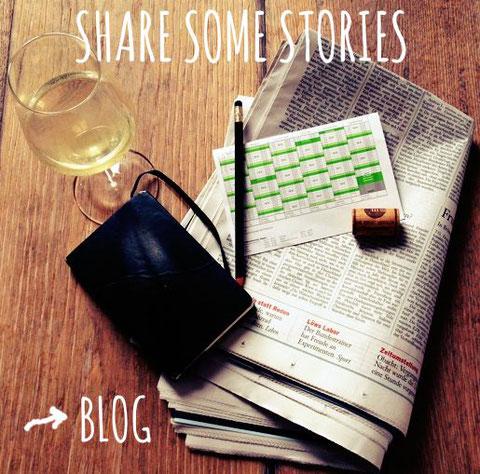 wine glass, newspaper and notebook