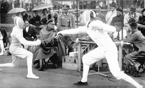 1936 Berlin: Fencing event in the rain before it was moved indoors