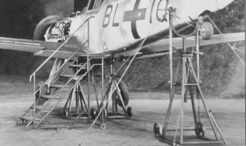 "Tail fork used on a gun calibration site. Note the ""Auswanderungsscheibe"" attached to the spinner on the nose of the aircraft."