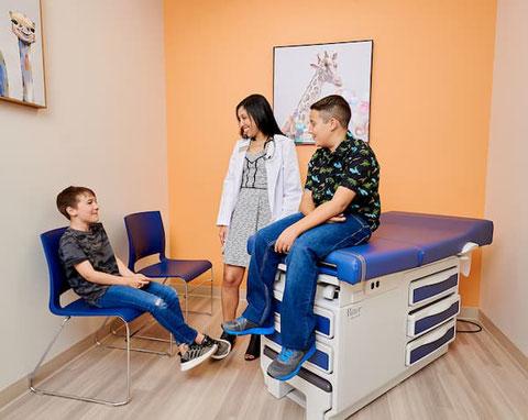 Nurse Practitioner Erika Mendoza-Hutto ARNP chatting with patients