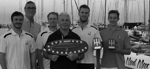 Crew of Mad Max receiving trophies at Australian Multihull Championships