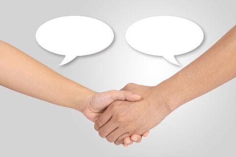 話し合いと握手
