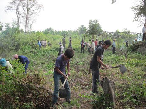 Picture 38: Community people helping each other to clear the land for the new school building