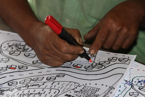 Picture 29: People from Somboun village in the process of updating the village map during the mid-term evaluation in 2010