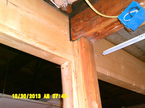New header shown with new support beam, that also supports the roof beam that runs front to back through 3/4 the length of the building. This beam supports the junction of three different roof angles. the roof had to be jacked up 1/4 inch at this point