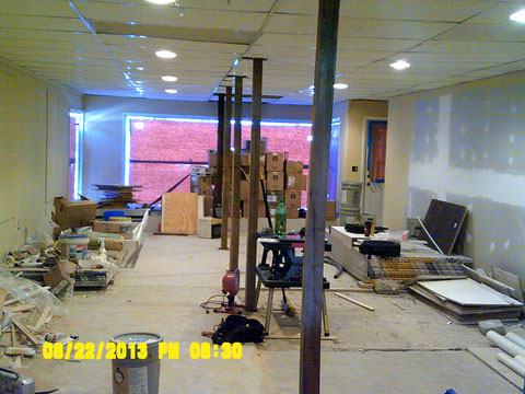 Standing near former back interior wall looking toward front of store