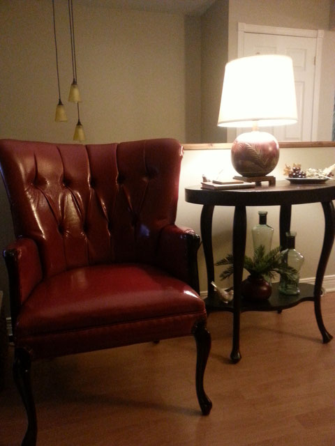 Antique chair reupholstered in dark red faux leather