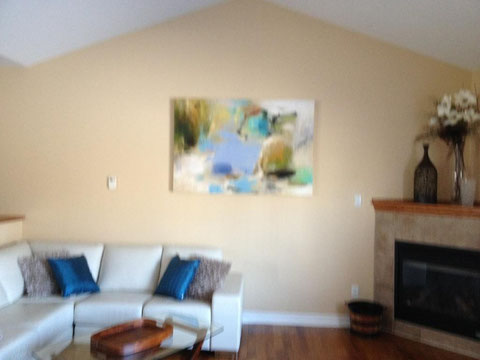 New art and new colourful cushions enhanced this home to sell quickly! The only thing needed was to lower the artwork about 5 inches.