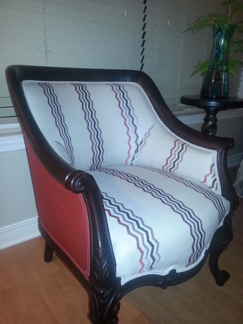 A beat up antique mahogany chair beautifully restored and reupholstered
