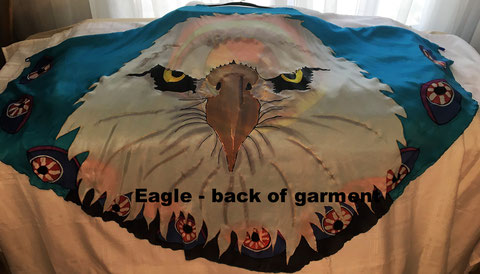 Sky Blue Cape Garment with large eagle face on it