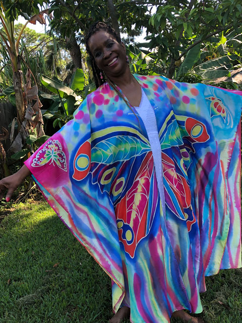 Big butterflies on a colorful flowing silk tunic