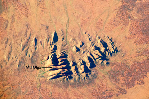 Located in the Northern Territory of Australia, Uluru-Kata Tjuta National Park hosts some of the world's most spectacular examples of inselbergs, or isolated mountains. The most famous of these inselbergs is Uluru (Ayers Rock), view from ISS. ©NASA-JSC.