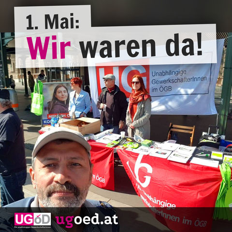 Erster Mai: Wir waren da! Auf der Wiener Ringstraße stehen Elke, Hasan und Mesud mit dem traditionellen Info-Stand der UG.