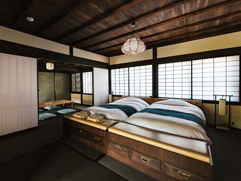 ベッドを多くして多人数を収容する民泊
