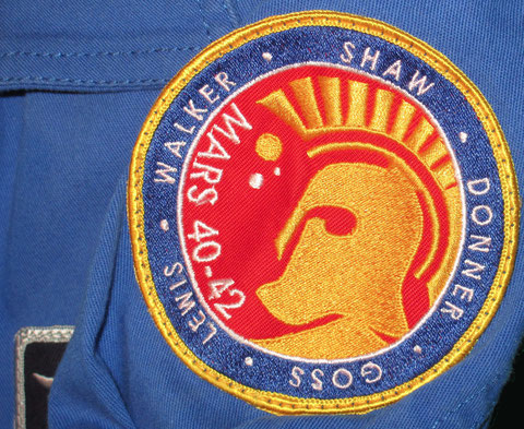 defying gravity maddux donner mars mission patch on instructor flightsuit