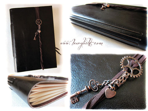 Lederbuch aus edlem, dunkelbraunen Leder mit kupferfarbenen Accessoires