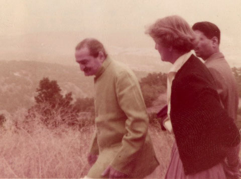 Avatar Meher Baba and Agnes Baron waling to Baba's Tree on August 2, 1956. Meher Baba's disciple Eruch Jessawala is in the background. (Archive photo.)