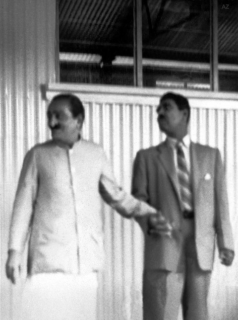 5th June 1958 ; Meher Baba with Eruch Jessawala outside his house. Photo taken by Colin Adams. Courtesy of Avatar Abode Archives.