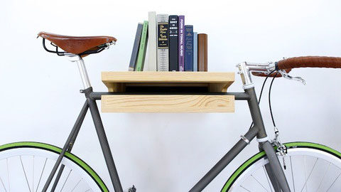 book shelf holding up a bicycle.