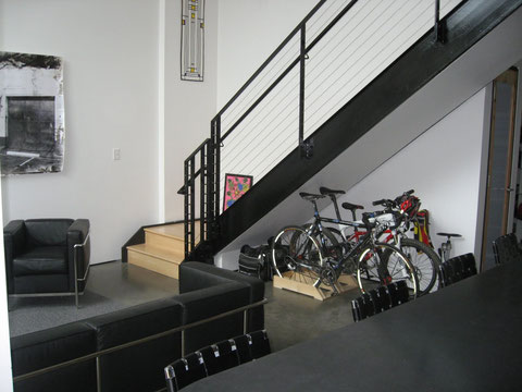 Bike rack under the stair case.