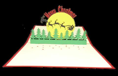 Carte kirigami Joyeux Noël avec le Père Noël dans son traineau