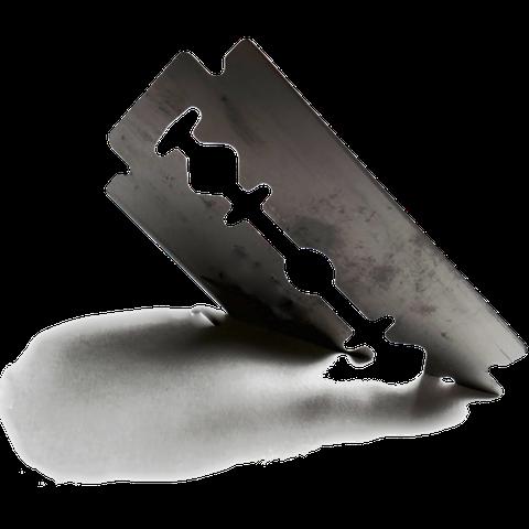 Schwarzweiß-Bild: Eine Rasierklinge schneidet durch Papier.