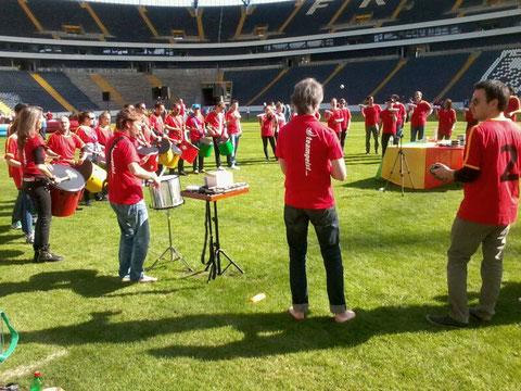 Picture of drummers during a teambuilding workshop in a soccer stadium