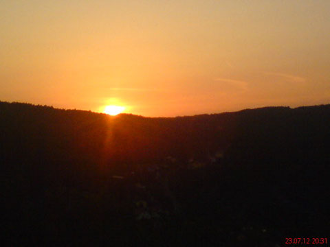 ...vom Raum der Blick auf die SüdOstSteirische Hügellandschaft bei Sonnenuntergang