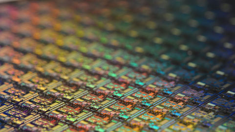 Silicon wafer. Each square is a chip with microscopic transistors and circuits.
