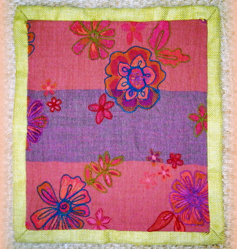 Pashmina with somber plum/maroon/purple base & large, thick, bright woolen, hand emroidered, floral designs. Mulberry satin backing (hidden zip), with puce yellow, sturdy, linen blend folded  edging.