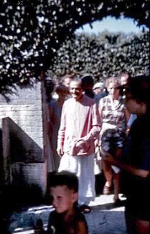 Meher Baba exploring the gardens with his entourage.1956 :  Image captured by Anthony Zois from a film by Sufism Reoriented