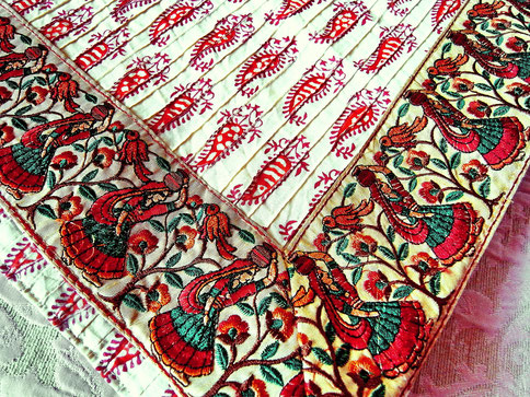 Cream, pinched pleat paisley block print, Indian cotton throw; close-up emroidered village women border
