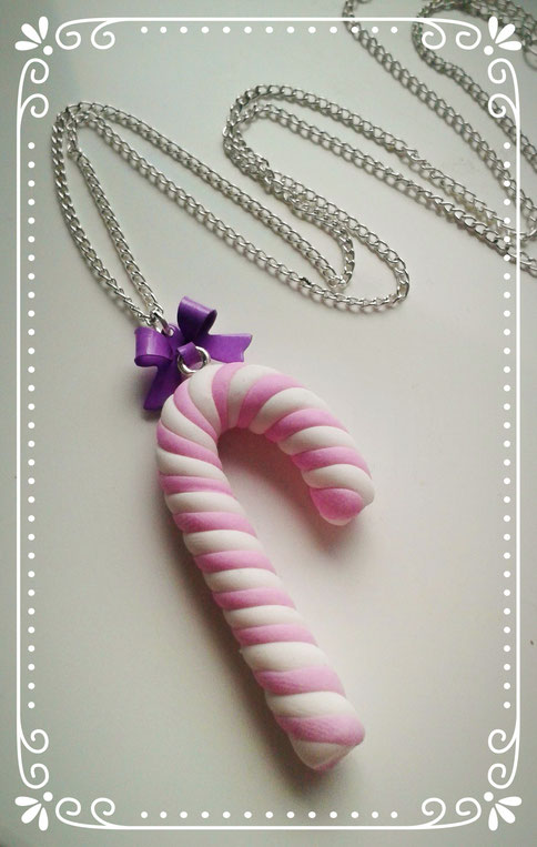 Pink & White Christmas Candy Cane necklace with a Purple Bow