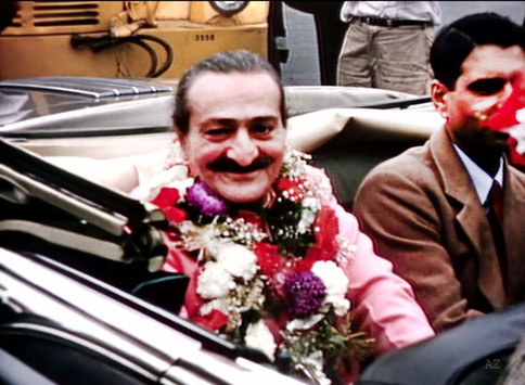 Meher Baba with Eruch Jessawala seated in the Florsheim's car at Idlewild Airport, New York having just arrived from India & Europe. Image captured by Anthony Zois from a film by Sufism Reoriented.