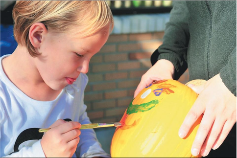 Lindsey Raav paints a pumpkin during last year's Pumpkinfest. This year's event is Oct. 4-6. Dennis R.J. Geppert/Sentinel staff