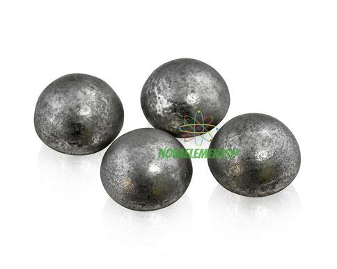 shiny tin metal element drops pellets