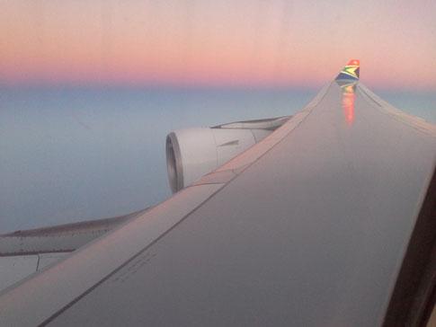Sonnenaufgang beim Anflug auf Johannesburg