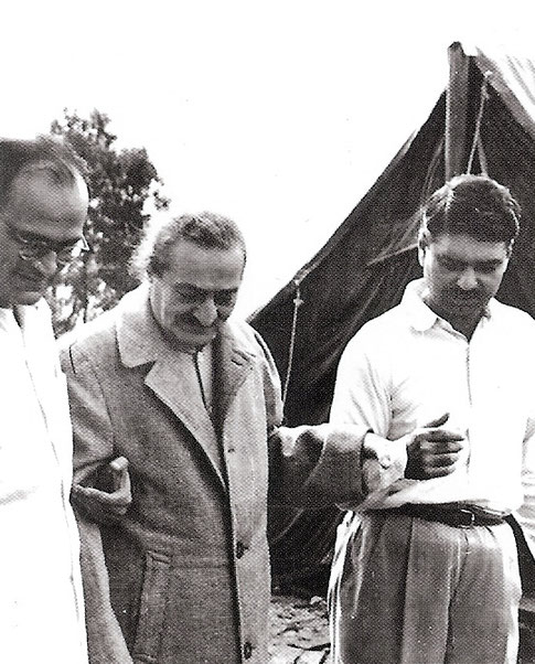 7.  Meher Baba at the Abode with Nariman Dadachanji ( L ) & Eruch Jessawala ( R ).  Photo taken by Colin Adams, courtesy of Avatar's Abode Archives.