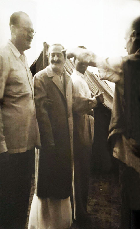 9.  Meher Baba with Nariman, Eruch with Francis Brabazon pointing to something.  Courtesy of Avatar's Abode Archives.