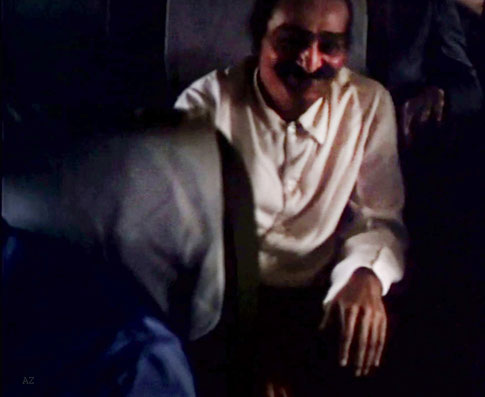 Meher Baba on the plane flying from Newark, NY., to Wilmington, NC.   Image captured from a film by Anthony Zois