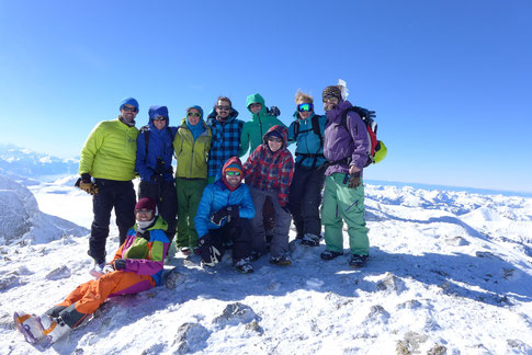 Snowboarders on the top