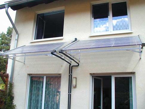 Einfamilienhaus in Kleinmachnow, Deutschland, Überdachnung der Terasse, 50 Direct Flow Power Röhren, Brauchwassererwärmung