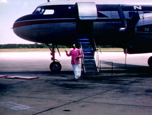 Meher Baba first steps at Wilmington Airport, NC. -  Image captured from a film by Anthony Zois
